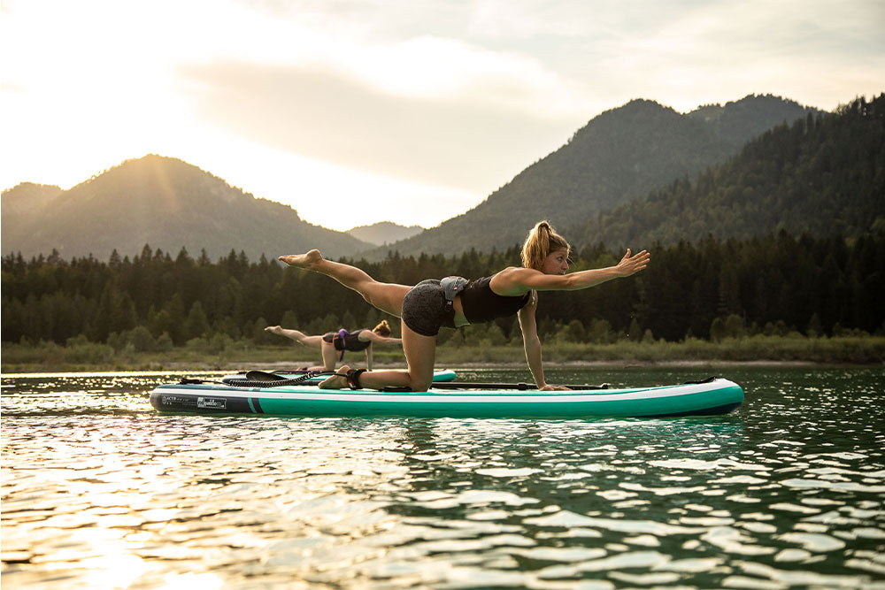 Woman Doing Yoga table Top Pose with opposite arm & leg extended