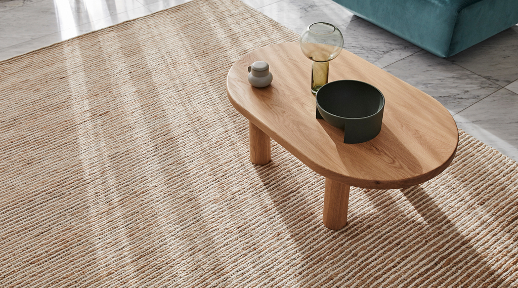 Weave rug styled with wood coffee table