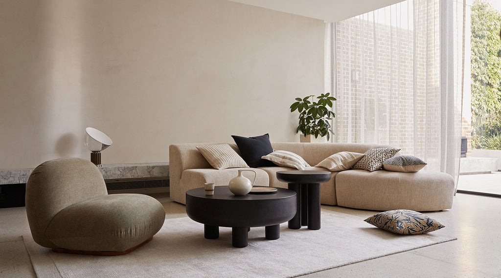 Mallorca collection by Weave. Stylish cushions. Cushions stacked on couch. Interior styling