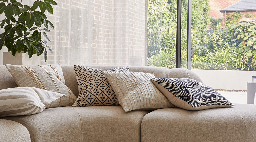 Mallorca Collection by Weave. Neutral cushions. Pattern cushions. Couch with cushions