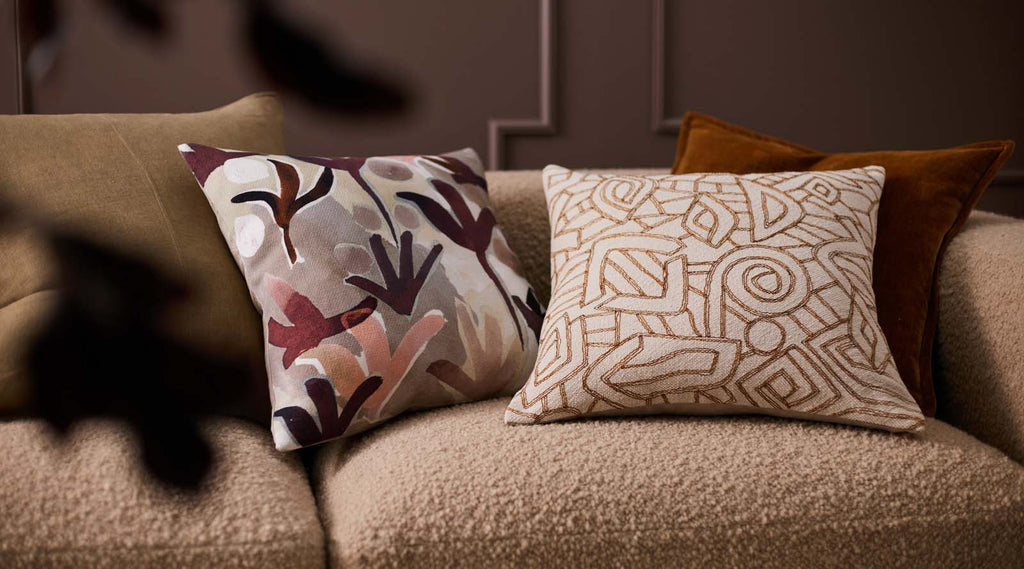 Nopi watercolour printed cushion on couch