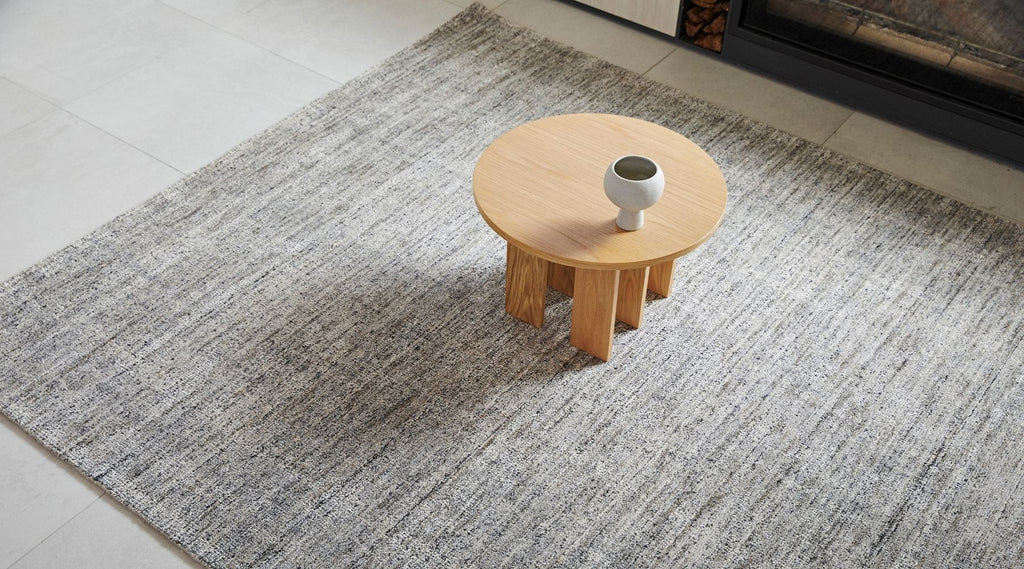 Granito Rug in Shale by Weave home. Bamboo silk rug styled with coffee table