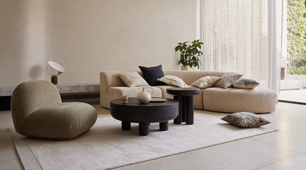 Travertine rug by Weave. Woollen rugs styled with modern couch