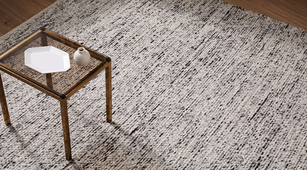 Weave home dolomite rug in pepper styled with antique coffee table. Black and white rug