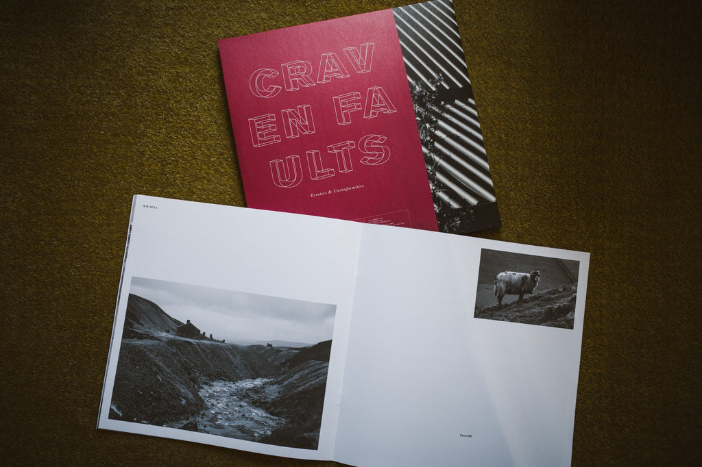 Picture of back cover and accompanying photobook of Craven Faults Erratic & Unconformities vinyl LP.