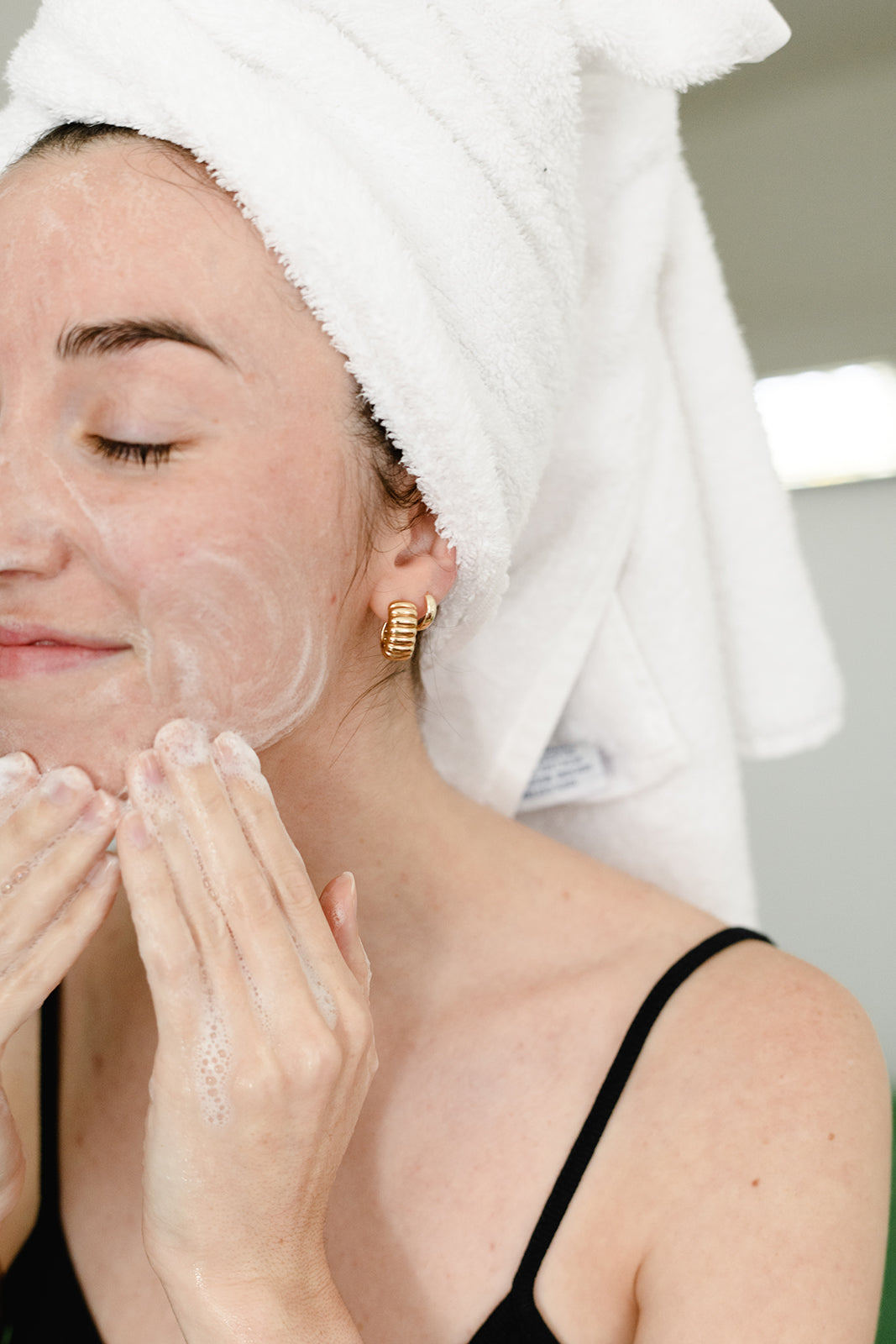 core four must haves for all skin types - girl using cleanser