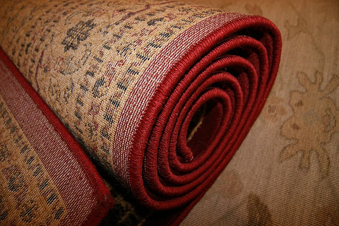 how to stop rugs creeping on carpet