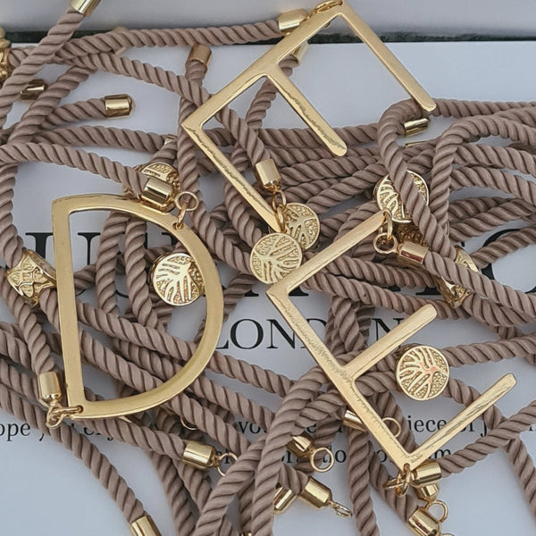 GOLD 'TRAPEZE' INITIAL CORD BRACELET