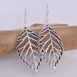 E632 - Silver cut out leaf earrings