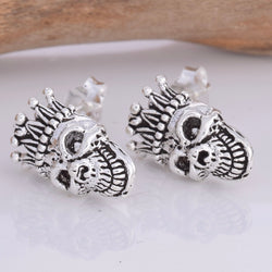 S591 - Heavy silver skull with crown stud earrings