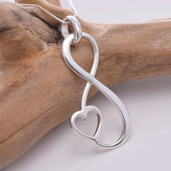 P693 - Large infinity loop with heart pendant