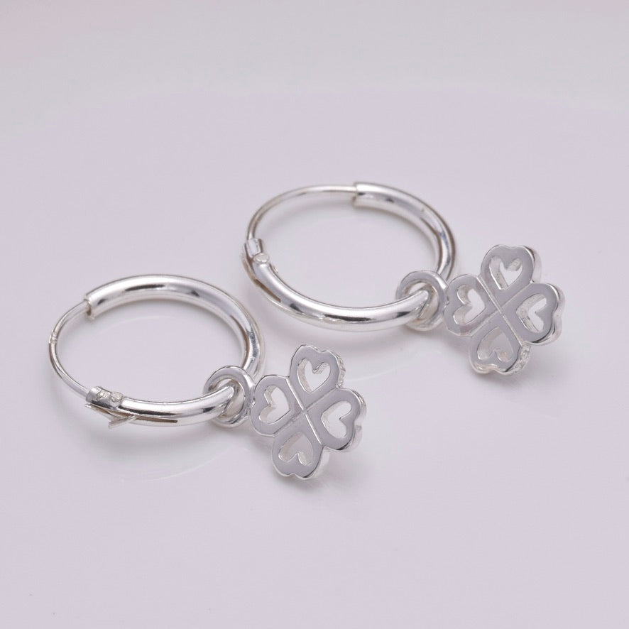 E643 - Silver hoop and four leaf clover