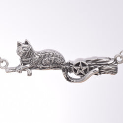 P443 - Cat on a broomstick necklace
