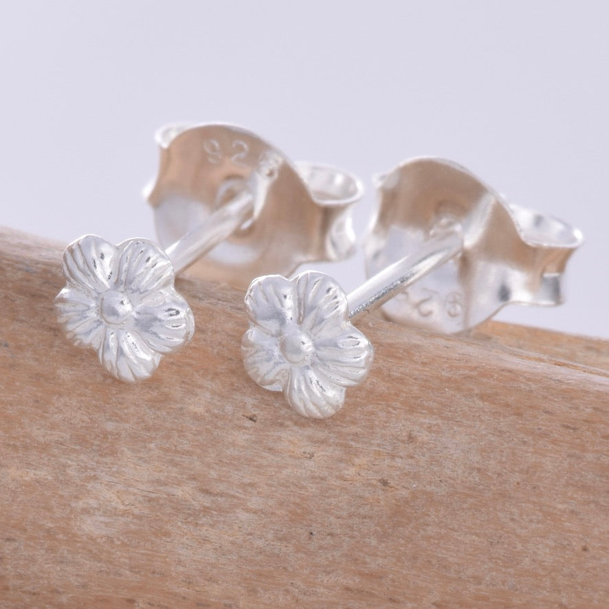 S597 - Tiny silver hibiscus stud earrings