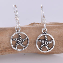 E622 - Starfish inside disc silver earrings