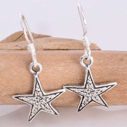 E565 - Silver star drop earrings