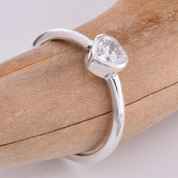 R143 - Silver band ring with clear CZ heart stone