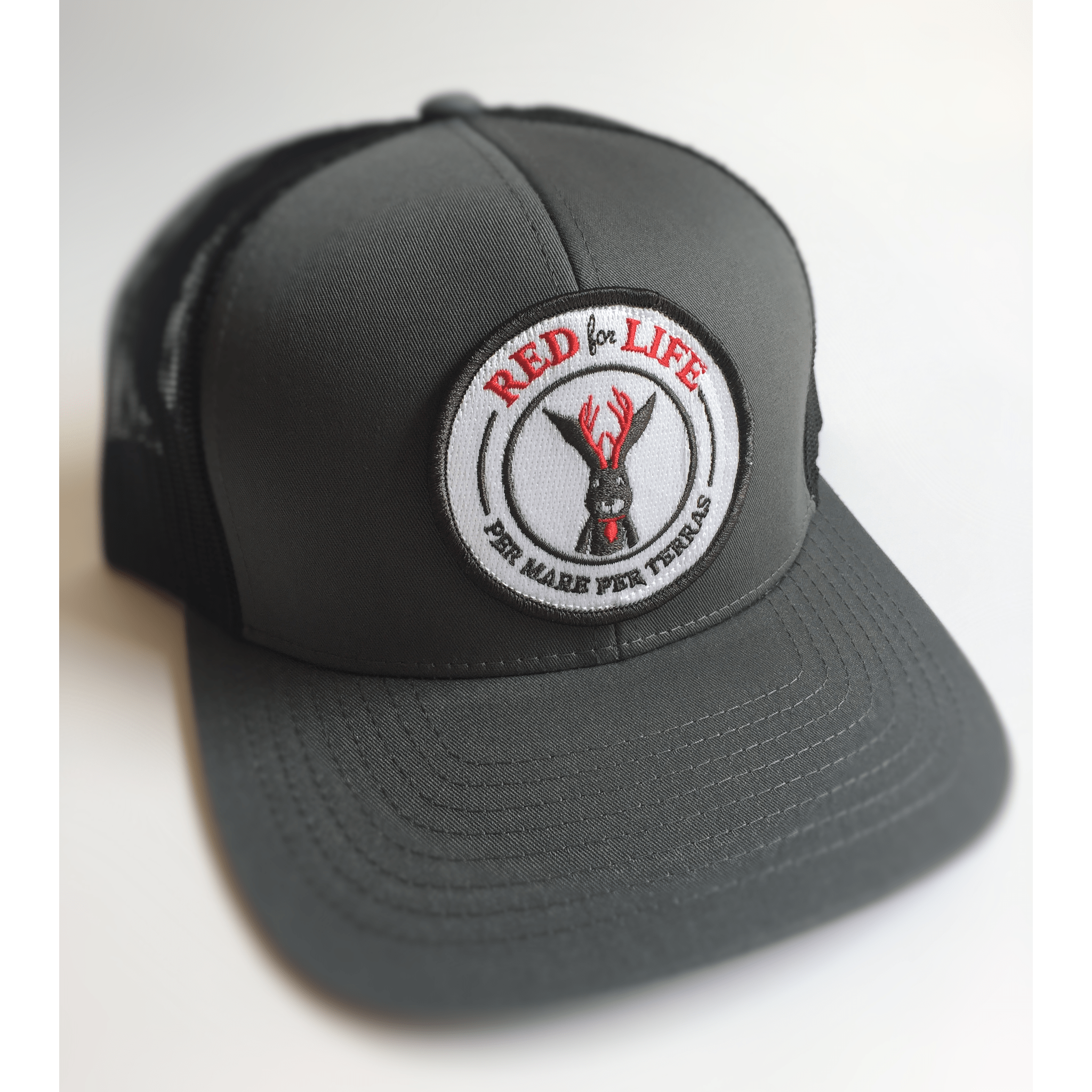 f134fe80c9e Red for Life Graphite Black Trucker Hat