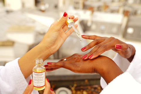 Our Marrouge Beauty Radiance Facial Oil applied on models' hands