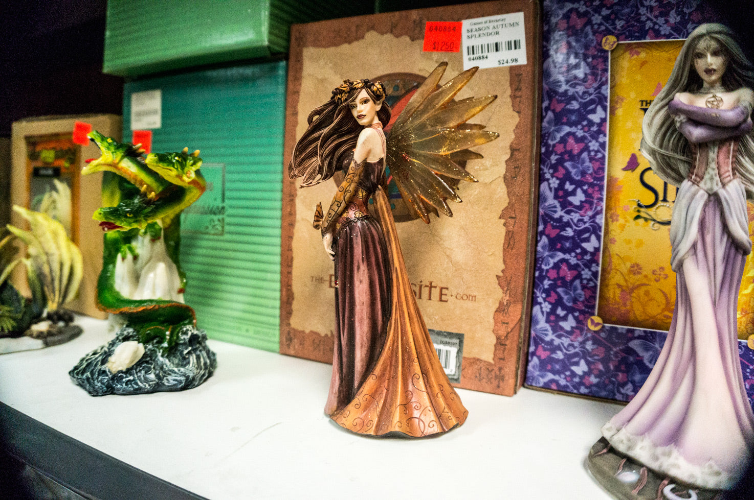Collectible statues of dragons and fairies at Games of Berkeley Backroom Bargains