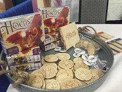 Hocus on display with wooden promo tokens!