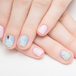 Flower designs on blue and pink liquid gel nails