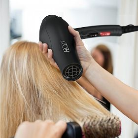 Woman receiving blow dry after a hair cut