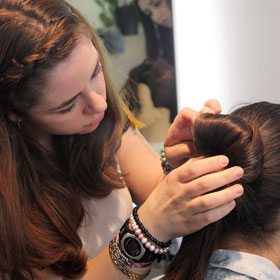 Woman receiving high quality fashionable hair style colour treatment from professional hairdresser
