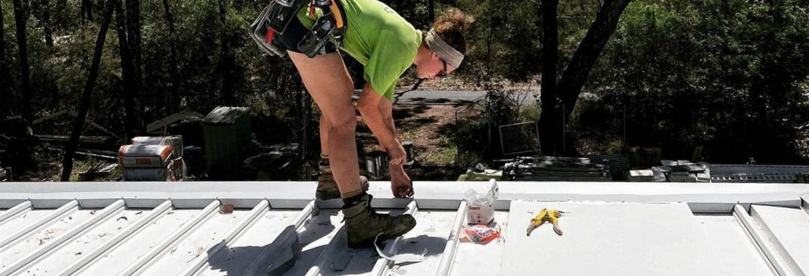 woman carpenter working on roof