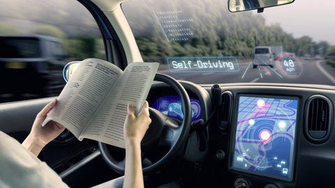 Woman reading why driving