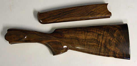 AAA grade = premium grade English walnut with approximately 75 percent figure in both sides of stock behind wrist.