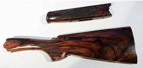 Exhibition grade= premium grade English walnut with approximately 75 percent or more figure in both sides of stock behind wrist, with similar pattern on both sides of stock.