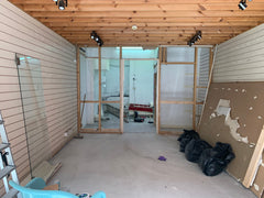Interior of the shop with building rubble everywhere