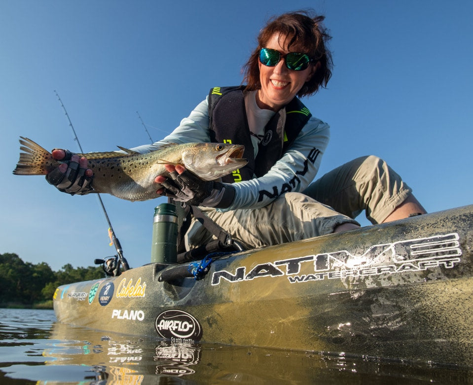 Angler proudly holding up fish caught in a Native Watercraft Slayer Propel 10