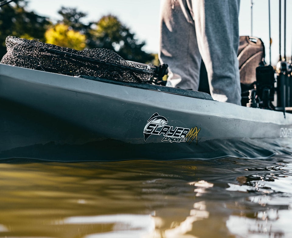 Close-up of the base of a Slayer Max Propel 12.5 in the water