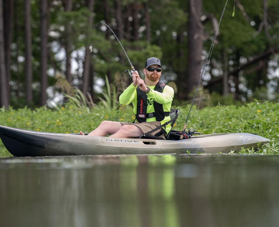 Angler casting a line sitting in their Native Watercraft 13.5