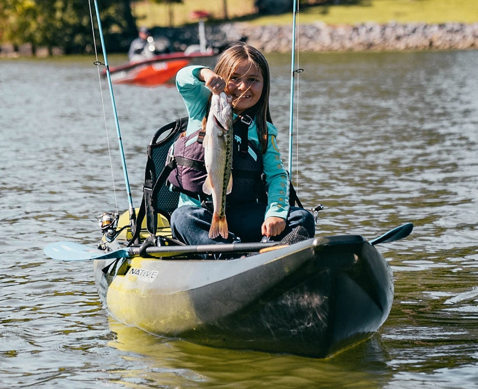 Young girl holding fish caught in a Native Watercraft Stingray 11.5