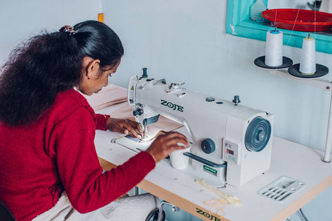 One of the AMMA's, an artisan, sewing