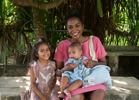 Devi, founder of Sambol Setting, with her two children.