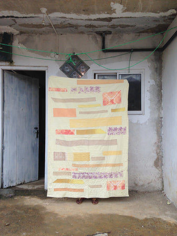 Handmade patchwork blanket made using naturally dyed fabric in our workshop in Sri Lanka.
