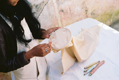 Sheromi doing embroidery with our naturally dyed yarns