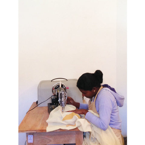 One of our AMMA's stitching a handmade quilt