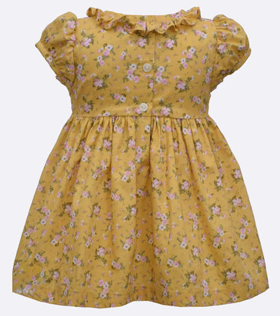 little girls floral dress with smocked insert and ruffle collar