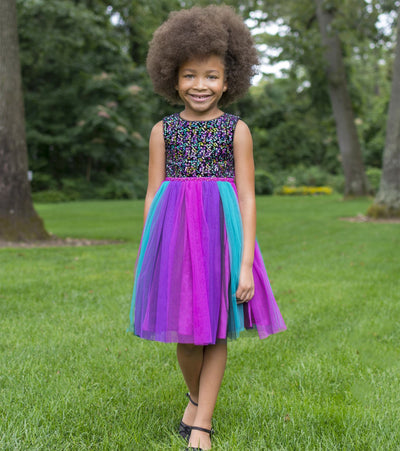 Matching party dress for sisters with multi color sequin top and rainbow mesh skirt