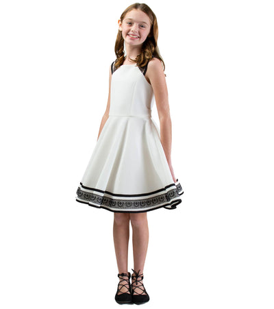 Black and white skater dress with border and strap detail