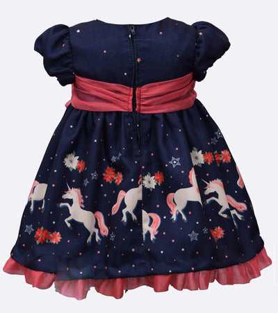 little girls party dress with unicorn print and large pink bow detail