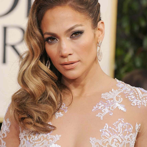 6.Sideswept wavy hairstyle with twists