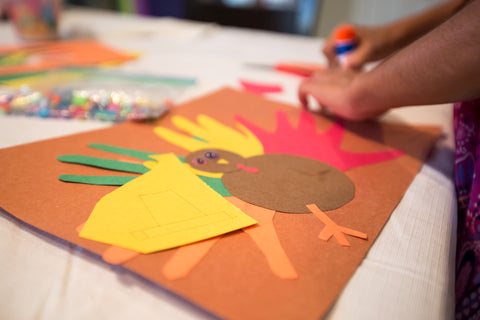 kid-making-handprint-turkey-for-thanksgiving-arts-and-crafts