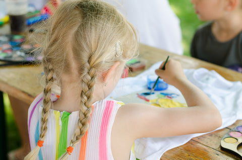 blonde-girl-painting-tshirt-with-paintbrush