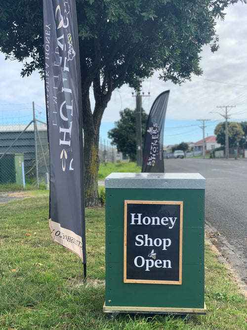 Settlers Honey Shop - Visit out store - Flag and Honey Shop Open sign
